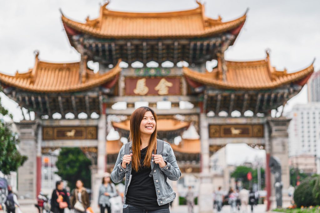 Asian traveler woman looking and sightseeing when travelling ove