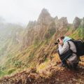 Santo Antao Island, Cape Verde. Hiking outdoor activity. Male traveler photographing mountain peaks in surreal Xo Xo valley